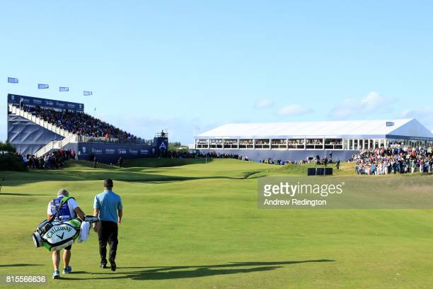 Callum Shinkwin of England and caddie Andy Andy Sutton walk down the 18th hole during the final round of the AAM Scottish Open at Dundonald Links...