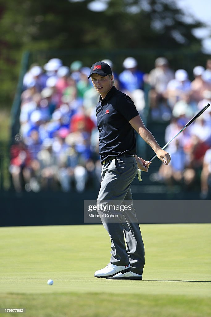 Callum Shinkwin of England and the Great Britain and Ireland team reacts to his missed putt on the sixth green during the afternoon singles matches on Day One of the 2013 Walker Cup at National Golf Links of America on September 7, 2013 in Southampton, New York.
