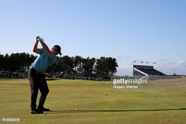 Callum Shinkwin of England hits his second shot on the 18th hole during the final round of the AAM Scottish Open at Dundonald Links Golf Course on...