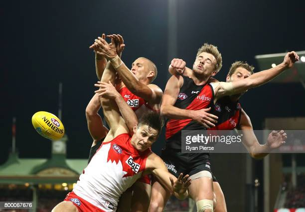 Callum Sinclair and Sam Reid of the Swans competes for the ball against Martin Gleeson and Tom Bellchambers of the Bombers during the round 14 AFL...