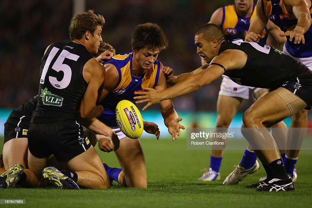 Callum Sinclair of the Eagles attempts to gather the ball during the round five AFL match between Port Adelaide Power and the West Coast Eagles at AAMI Stadium on April 27, 2013 in Adelaide, Australia.