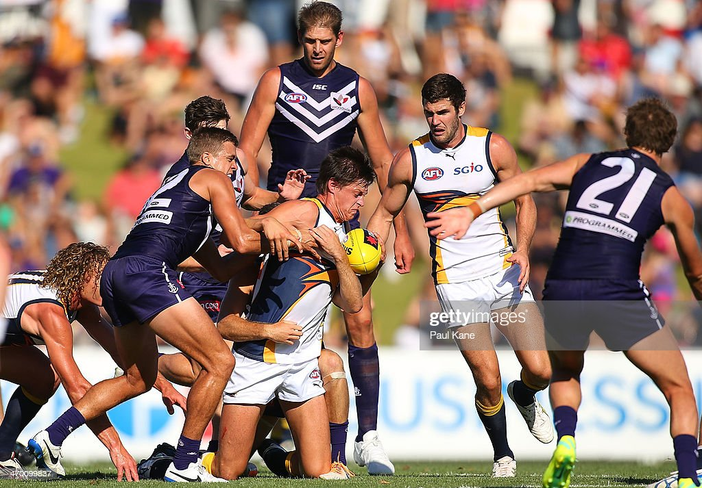 Callum Sinclair of the Eagles gets tackled during the round two NAB Challenge Cup AFL match between the Fremantle Dockers and the West Coast Eagles at Arena Joondalup on February 18, 2014 in Perth, Australia.