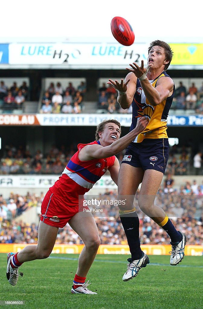 Callum Sinclair of the Eagles marks the ball against Jack Macrae of the Bulldogs during the round six AFL match between the West Coast Eagles and the Western Bulldogs at Patersons Stadium on May 5, 2013 in Perth, Australia.