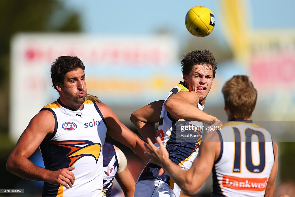 Callum Sinclair of the Eagles palms the ball to Scott Selwood during the round two NAB Challenge Cup AFL match between the Fremantle Dockers and the West Coast Eagles at Arena Joondalup on February 18, 2014 in Perth, Australia.