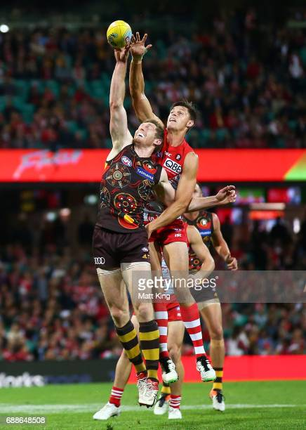 Callum Sinclair of the Swans competes for the ball against Ben McEvoy of the Hawks during the round 10 AFL match between the Sydney Swans and the...
