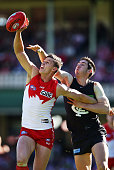 Callum Sinclair of the Swans is challenged by Jacob Weitering of the Blues during the round 18 AFL match between the Sydney Swans and the Carlton...
