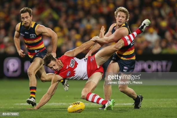 Callum Sinclair of the Swans is tackled by Rory Sloane of the Crows during the 2017 AFL round 22 match between the Adelaide Crows and the Sydney...