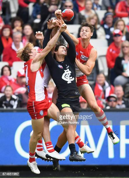 Callum Sinclair of the Swans spoils a mark by Jack Silvagni of the Blues during the round six AFL match between the Carlton Blues and the Sydney...
