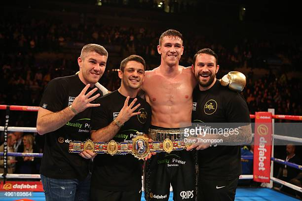 Callum Smith stands alongside brothers Liam Stephen and Paul Smith after beating Rocky Fielding during their Super Middleweight contest at the Echo...