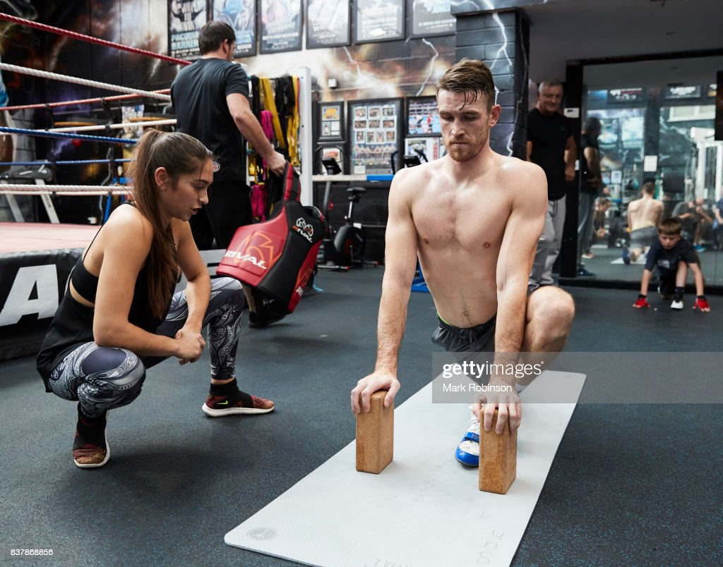 Callum Smith stretches off after a training session with his yoga teacher Raquelle Gracie at Gallaghers Gym on August 23, 2017 in Bolton, England.