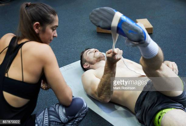 Callum Smith stretches off after a training session with his yoga teacher Raquelle Gracie at Gallaghers Gym on August 23 2017 in Bolton England