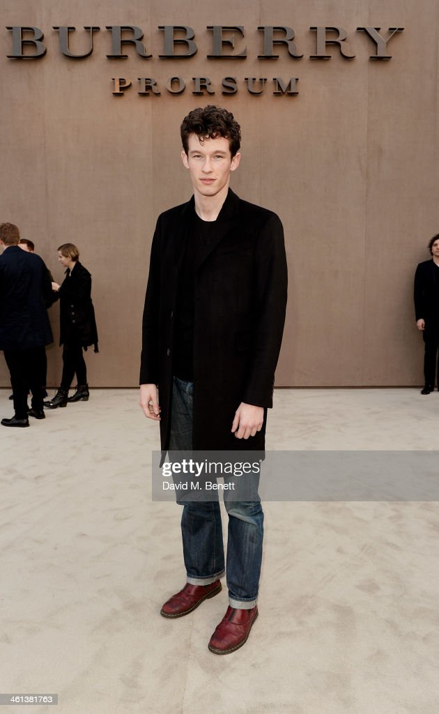 Callum Turner arrives at the Burberry AW14 Menswear Show at Kensington Gardens on January 8, 2014 in London, England.