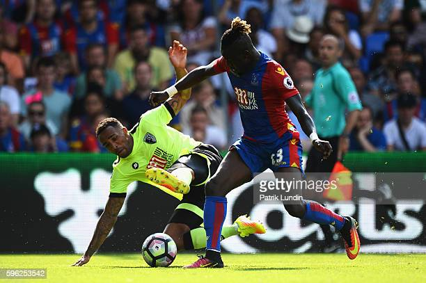 Callum Wilson of AFC Bournemouth battles with Pape Souare of Crystal Palace during the Premier League match between Crystal Palace and AFC...