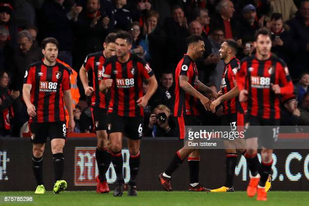 Callum Wilson of AFC Bournemouth celebrates his side's fourth and his hat trick goal with his team mates during the Premier League match between AFC...