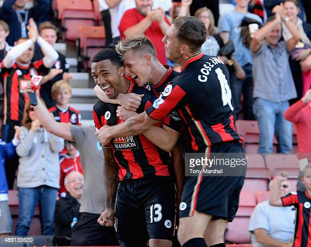 Callum Wilson of AFC Bournemouth celebrates scoring their first goal with Matt Ritchie and Dan Gosling during the Barclays Premier League match...