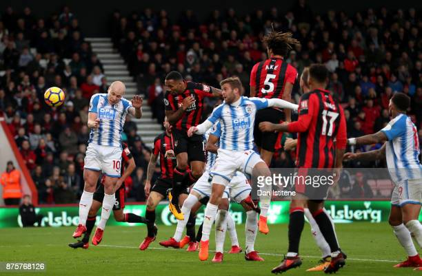Callum Wilson of AFC Bournemouth heads the ball to score the opening goal during the Premier League match between AFC Bournemouth and Huddersfield...