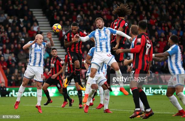 Callum Wilson of AFC Bournemouth heads to score the opening goal during the Premier League match between AFC Bournemouth and Huddersfield Town at...