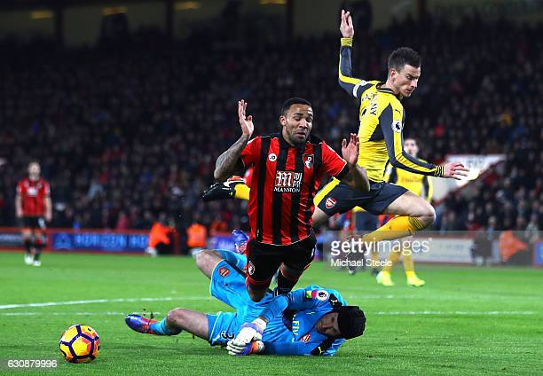 Callum Wilson of AFC Bournemouth is challenged by Petr Cech of Arsenal in the penalty box during the Premier League match between AFC Bournemouth and...