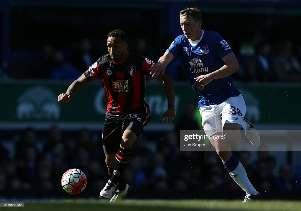Callum Wilson of Bournemouth and Matthew Pennington of Everton compete for the ball during the Barclays Premier League match between Everton and A.F.C. Bournemouth at Goodison Park on April 30, 2016 in Liverpool, England.