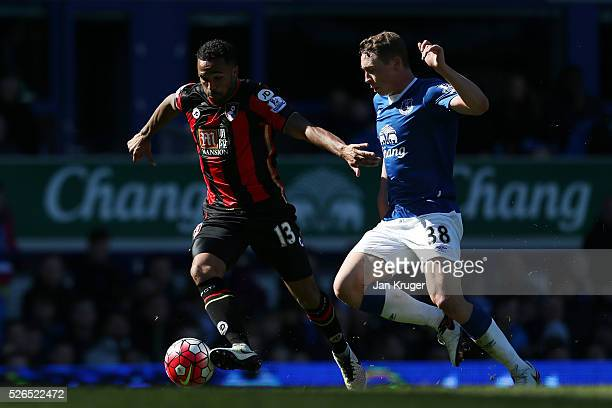 Callum Wilson of Bournemouth and Matthew Pennington of Everton compete for the ball during the Barclays Premier League match between Everton and AFC...