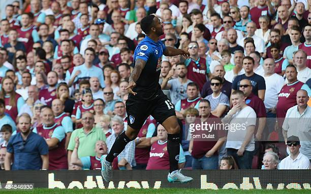Callum Wilson of Bournemouth celebrates scoring his team's first goal during the Barclays Premier League match between West Ham United and AFC...