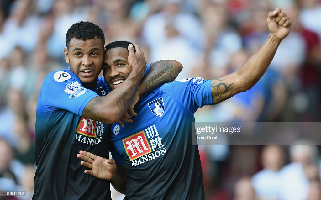 Callum Wilson (R) of Bournemouth celebrates scoring his team's first goal with his team mate Joshua King (L) during the Barclays Premier League match between West Ham United and A.F.C. Bournemouth at the Boleyn Ground on August 22, 2015 in London, England.