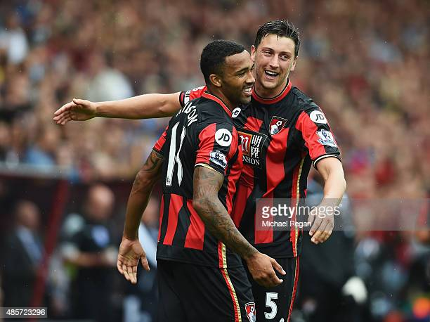 Callum Wilson of Bournemouth celebrates scoring his team's first goal with his team mate Tommy Elphick during the Barclays Premier League match...