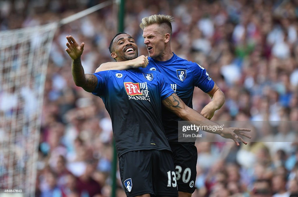 Callum Wilson (L)of Bournemouth celebrates scoring his team's second goal with his team mate Matt Ritchie (R) during the Barclays Premier League match between West Ham United and A.F.C. Bournemouth at the Boleyn Ground on August 22, 2015 in London, England.
