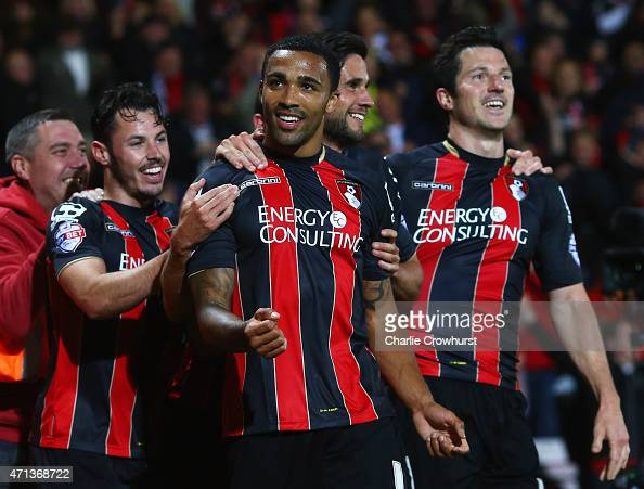 Callum Wilson of Bournemouth celebrates with team mates as he scores their third goal during the Sky Bet Championship match between AFC Bournemouth...