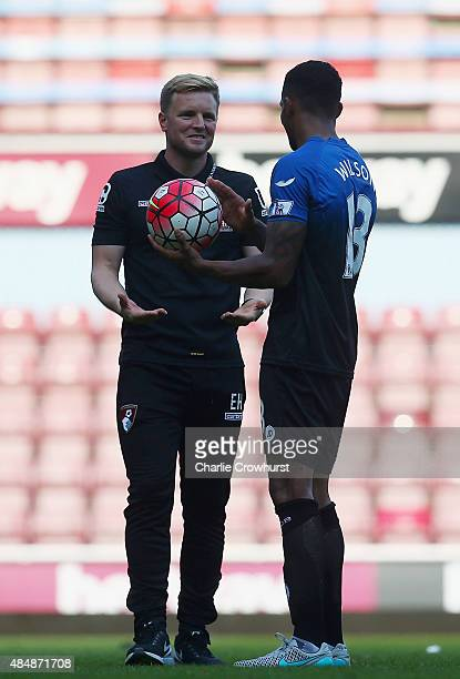 Callum Wilson of Bournemouth holds the match ball away from Manager Eddie Howe because of his hat trick after the Barclays Premier League match...
