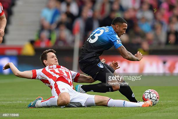 Callum Wilson of Bournemouth is fouled by Philipp Wollscheid of Stoke City during the Barclays Premier League match between Stoke City and AFC...