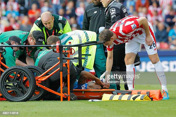 Callum Wilson of Bournemouth is taken by a stretcher after his injury during the Barclays Premier League match between Stoke City and AFC Bournemouth...
