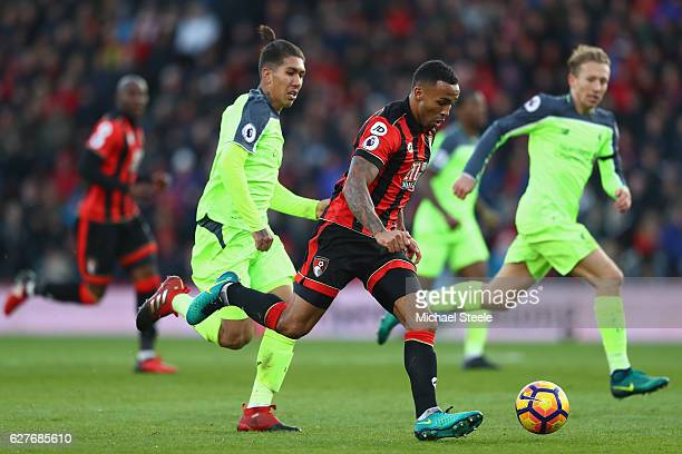 Callum Wilson of Bournemouth is tracked by Roberto Firmino of Liverpool during the Premier League match between AFC Bournemouth and Liverpool at the...
