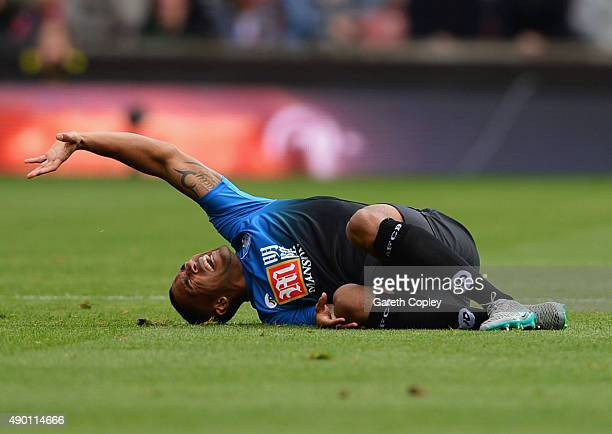Callum Wilson of Bournemouth lies on the ground after his injury during the Barclays Premier League match between Stoke City and AFC Bournemouth at...