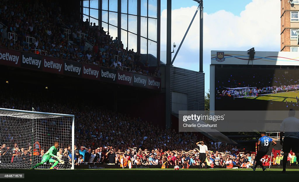 Callum Wilson of Bournemouth scores his team's fourth goal from the penalty spot to make a hat trick during the Barclays Premier League match between West Ham United and A.F.C. Bournemouth at the Boleyn Ground on August 22, 2015 in London, England.