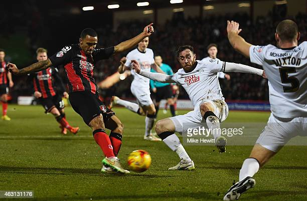 Callum Wilson of Bournemouth shoots past Richard Keogh of Derby Coutny to score their second goal during the Sky Bet Championship match between AFC...