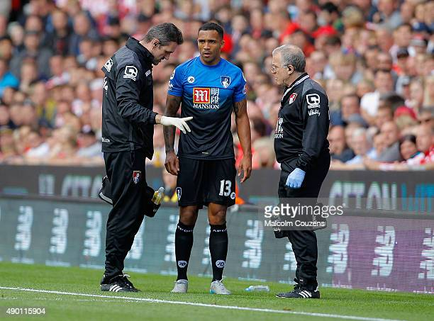 Callum Wilson of Bournemouth talks with medical staffs on the sideline during the Barclays Premier League match between Stoke City and AFC...