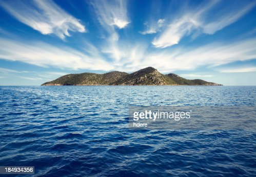 Calm blue water surrounds an island