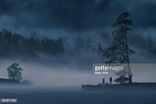 Calm lake in frosty fog