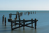 Calm early morning at the remains of Swanage Old Pier, Isle of Purbeck, Dorset