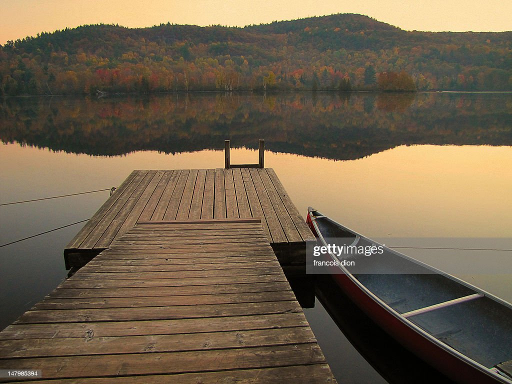 Calm river with canoe