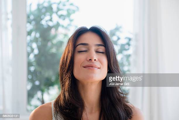 Calm woman breathing with eyes closed
