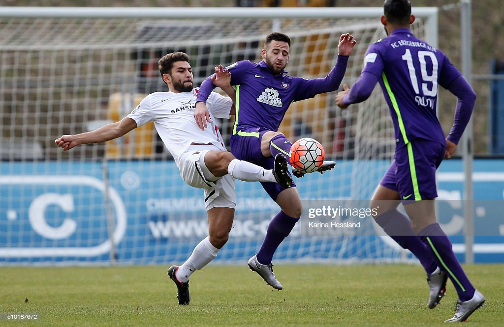 Calogero Rizzuto of Aue challenges Nejmeddin Daghfous of Wuerzburg during the Third League match between FC Erzgebirge Aue and Wuerzburger Kickers at Erzgebirgsstadion on February 14, 2016 in Aue, Germany.