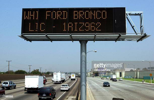Caltrans freeway sign over Interstate 5 flashes the description of a kidnapping suspect's vehicle in addition to 'child abduction 1 800 TELL CHP' as...
