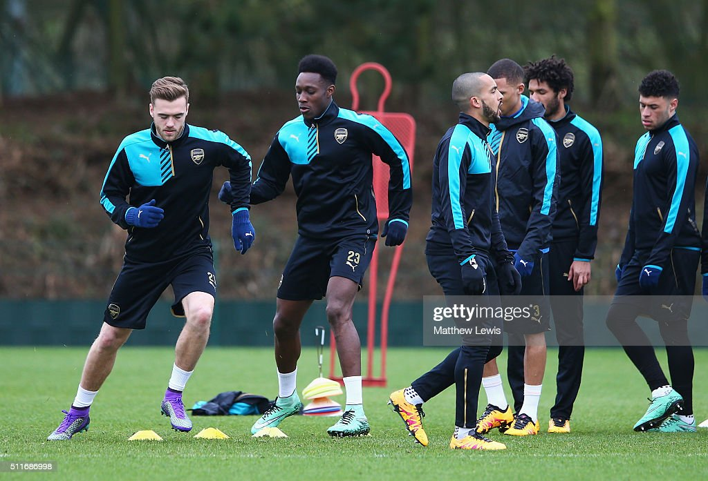 Calum Chambers (L) and Danny Welbeck warm up with team mates during the Arsenal training session ahead of the UEFA Champions League match against Barcelona at London Colney on February 22, 2016 in St Albans, United Kingdom.