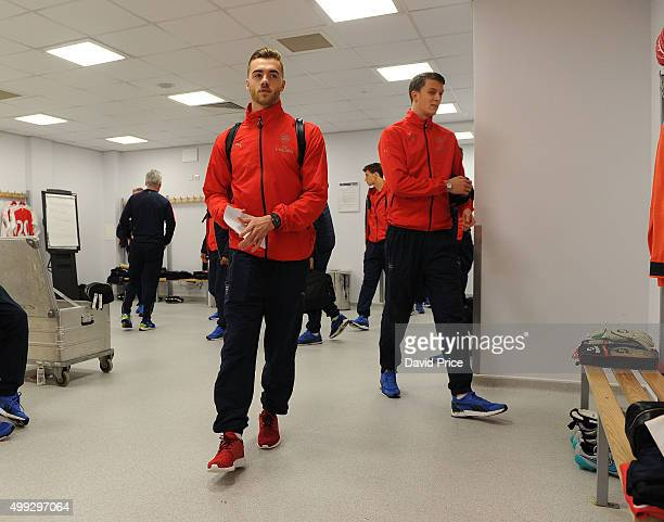 Calum Chambers and Matt Macey of Arsenal enter the changingroom on arrival at the stadium before the match between Brighton and Hove Albion U21 and...