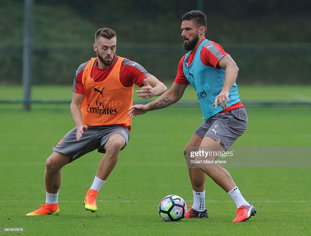 Calum Chambers and Olivier Giroud of Arsenal during a training session at London Colney on August 19 2016 in St Albans England