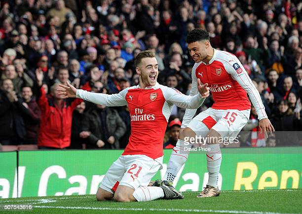Calum Chambers celebrates scoring a goal for Arsenal with teammate Alex OxladeChamberlain during the match between Arsenal and Burnley in the FA Cup...