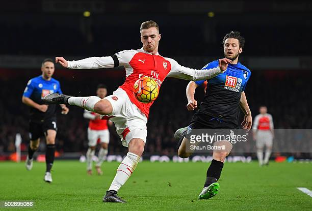 Calum Chambers of Arsenal and Harry Arter of Bournemouth compete for the ball during the Barclays Premier League match between Arsenal and AFC...