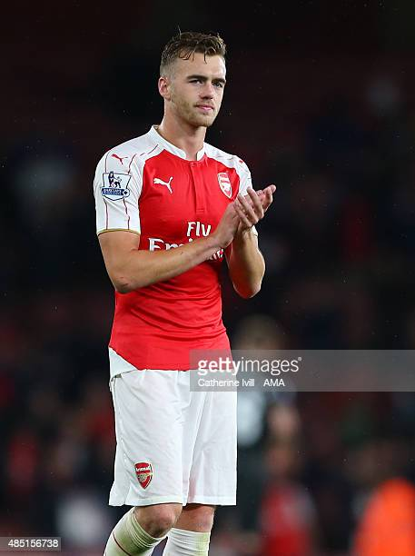 Calum Chambers of Arsenal applauds after the Barclays Premier League match between Arsenal and Liverpool at the Emirates Stadium on August 24 2015 in...